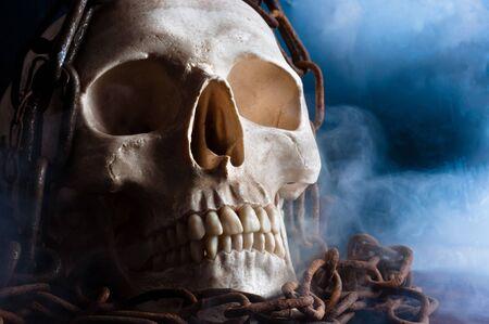 human skull with chain and smoke photo