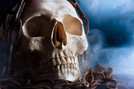 human skull with chain and smoke photo