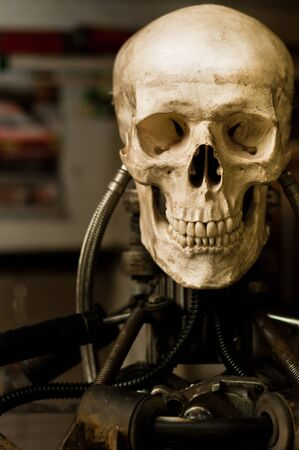 Human skull on robot body close up