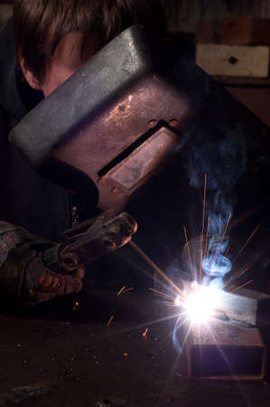 A factory welder at work Stock Photo - 9485711