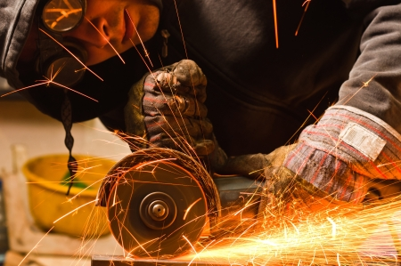 Worker cutting metal with many sharp sparks Stock Photo - 9486583