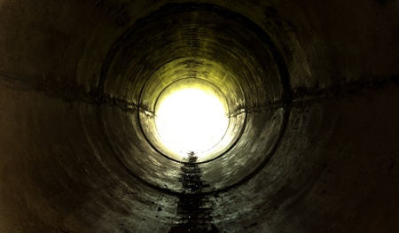 sewer pipe: Underground tunnel leading towards the light