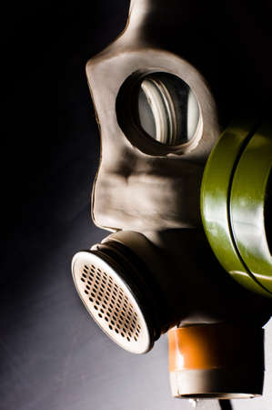 Dark gasmask on enlighted background Stock Photo - 9485585