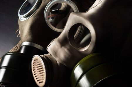 Closeup of a gasmask with enlighted background photo