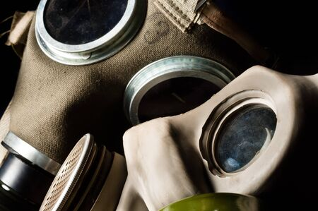 Two gasmask with focus on the grey one photo