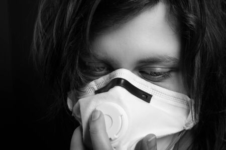 Closeup of a girl with protective mask photo