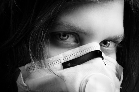 girl wearing protective mask in black and white photo