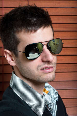 Portrait of a young man wearing sunglasses Stock Photo - 9511506