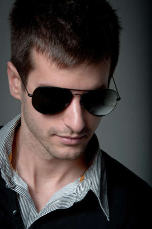 Portrait of a young man wearing sunglasses photo