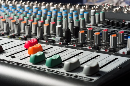Studio mixer with sliders and buttons photo
