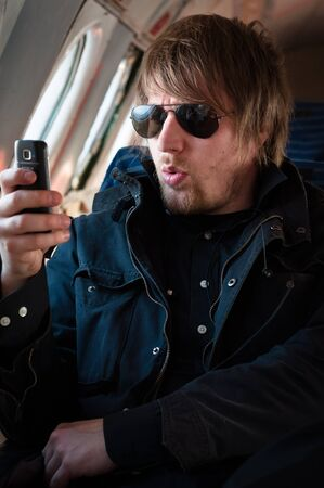Man in sunglasses sent wrong message on cellular phone Stock Photo - 9511173