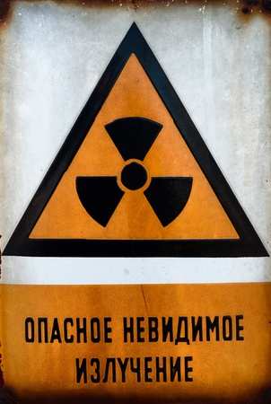 atomic symbol: Russian Beware of radiation sign in metal