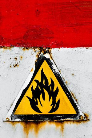 Beware of fire sign on rusty metal Stock Photo - 9511424