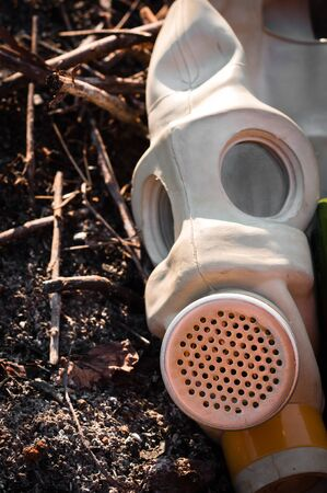 A gasmask on burnt ground Stock Photo - 9511319
