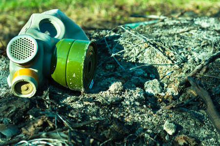 Vintage gasmask on burnt down ground Stock Photo - 9507206