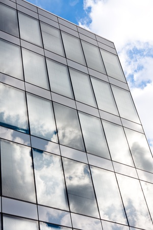 Modern office building with reflection of the sky Stock Photo - 9511355