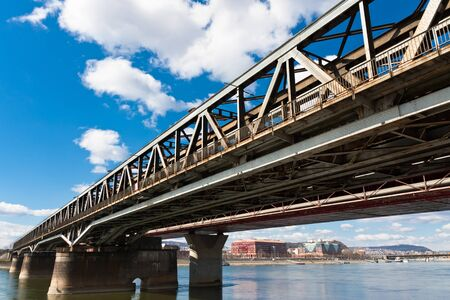 Angle view of a rusty bridge against blue sky Stock Photo - 9511099