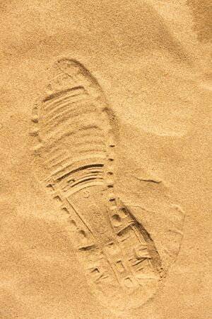 shoeprint: Shoeprint in the sand on the beach