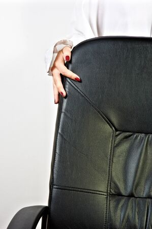 Business chair with a hand of a girl photo