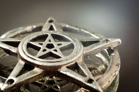 freemasonry: pentagram with reflection in the mirror an light