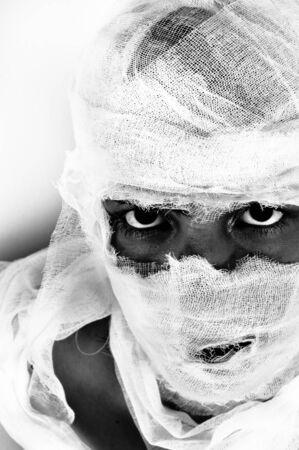 Scary portrait of a girl wrapped in bandage Stock Photo - 9913388