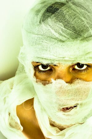 identified: Scary portrait of a girl wrapped in bandage Stock Photo