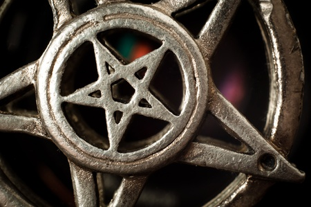 wicca: Pentagram with reflection macro shot Stock Photo