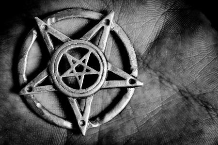 freemasonry: Pentagram in hand macro shot
