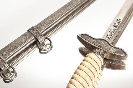 antiquary: World war knife and engraving on isolated white background Stock Photo
