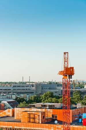 concrete commercial block: Construction sight with crane and buildings Stock Photo