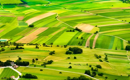 aerial view of green fields and slopes photo