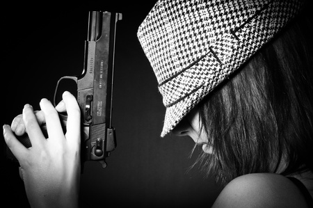 Girl in hat with a big pistol photo