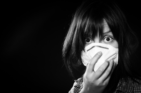girl wearing protective mask photo