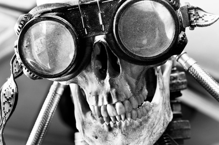 Human skull with insane look and goggles (robot) Stock Photo