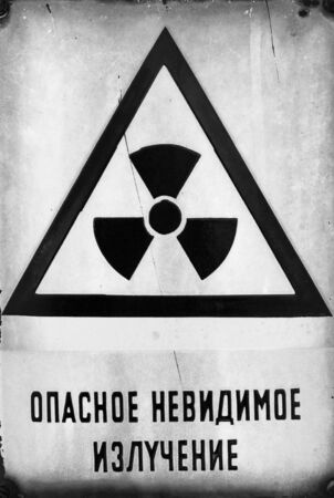 Russian Beware of radiation sign in metal photo