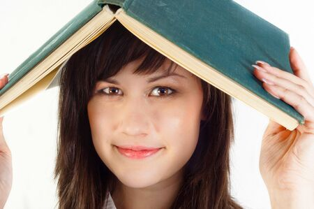 Young university student with a book on her her against white isolated background Stock Photo - 10536333