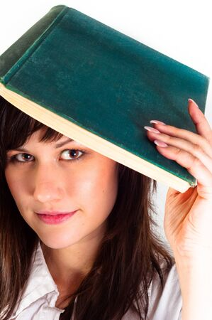Young girl and her book against white background Stock Photo - 10536312