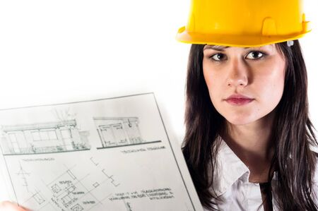 Pretty business woman in yellow helmet and her plans photo