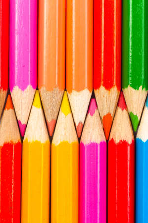 Texture of colorful pencils lined up in a row photo