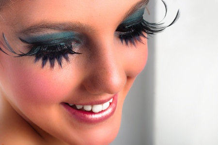 Closeup of a pretty girl with extreme makeup photo