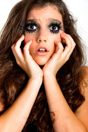 Terrified young girl with extreme makeup Stock Photo - 10880207