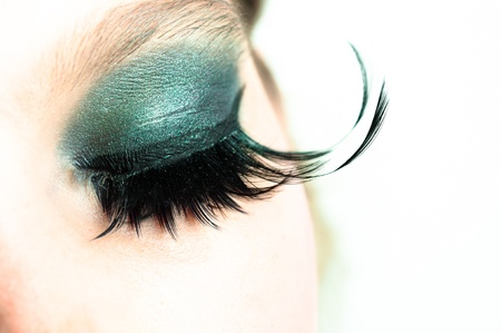 smoky eyes: Eye of a girl with extreme makeup Stock Photo