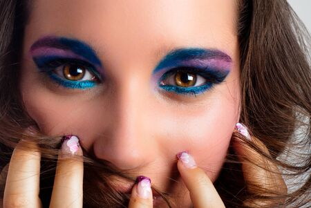 Young model with colorful makeup photo