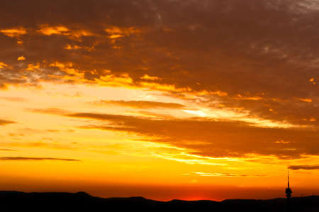 Red sunset with the silhouettes of some mountains Stock Photo - 10880112