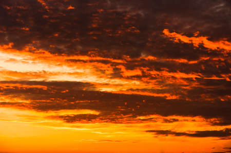 Sunset with orange clouds Stock Photo - 10880139