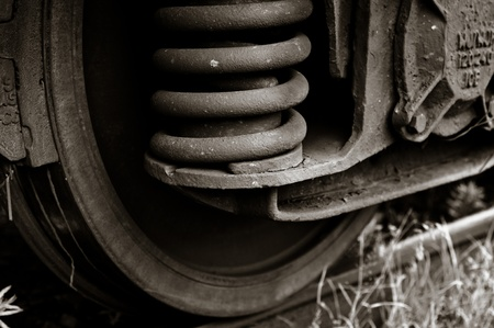 Wheels of a train with rust in black and white photo