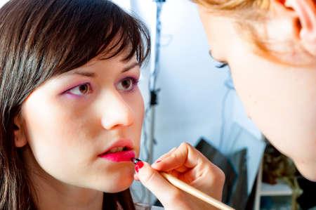 Model is getting prepared in the studio Stock Photo - 10880175