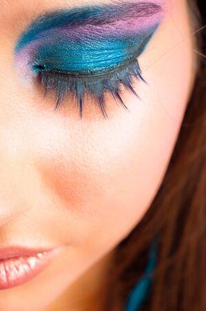 closeup photo of a girl with beautiful makeup and selected focus photo