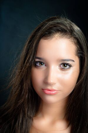 vouge: vouge photo of a young beautiful girl with cool background Stock Photo