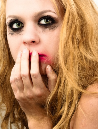 Scared girl with beautiful blond hair photo